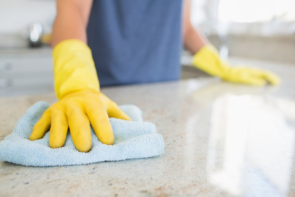 Woman cleaning kitchen to keep ants away