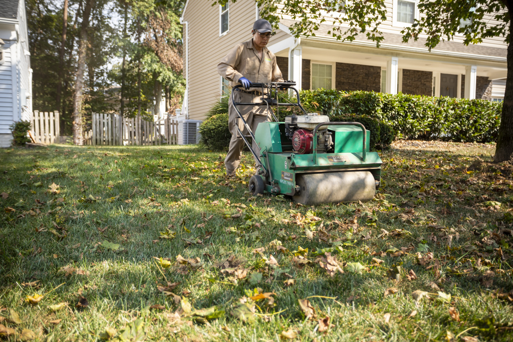 Natural Green lawn care technician caring for lawn in Bowie, MD